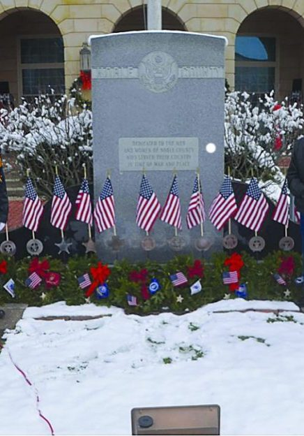 FRONT - Wreaths Across America photo of people posing around Veterans Monument at Noble County courthouse, ID's and cutline with story